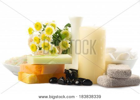 Flowers, candles, artisanal soap and stones - spa concept