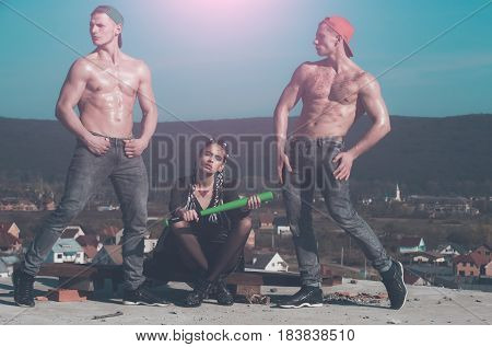 Fashionable Criminal Woman And Muscular Men With Baseball Bat