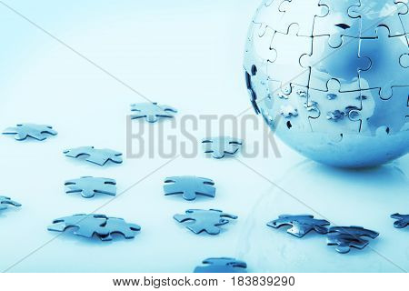Globe made out of puzzle pieces - global business/global problems concept