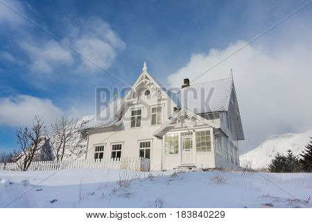A, Norway - March 18 2017: White wooden house in the fishing village of A in the Lofoten Islands Norway