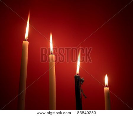 Holy religious candles burning creating a mysterious atmosphere.
