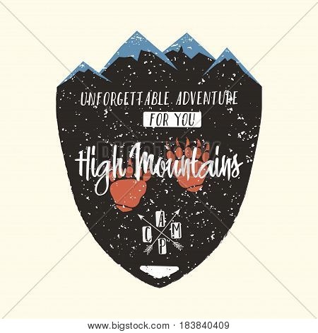 Adventure logo vintage hipster apparel emblem. High mountains typography poster badge with mountains bear's paw and lettering. Camping hiking climbing. Vector