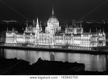 Building of Hungarian Parliament at night, main landmark of Budapest, black and white photo