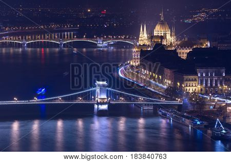 Night view of Budapest, building of The Hungarian Parliament and Chain Bridge, main landmarks in the city