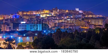 Night panorama of Cagliari old city center, wide angle view, Sardinia, Italy