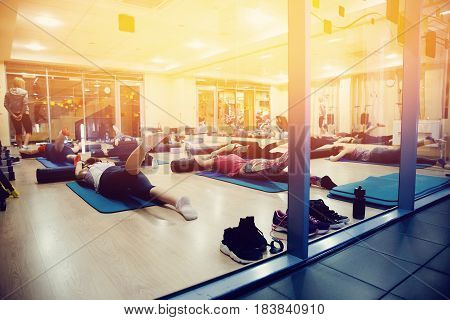 Girls fitness in a team and with friends. Concept Weight Loss. Strength of will. Psychological struggle.