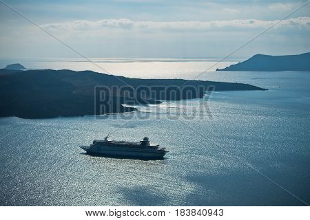 Volcano island with cruisers anchored around at Santorini, Greece