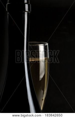 Champagne in a champagne flute with a dark background