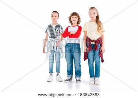 Cute kids standing and looking at camera isolated on white