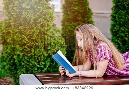 Ten Years Old Blue Eye Blonde Girl Reading Book