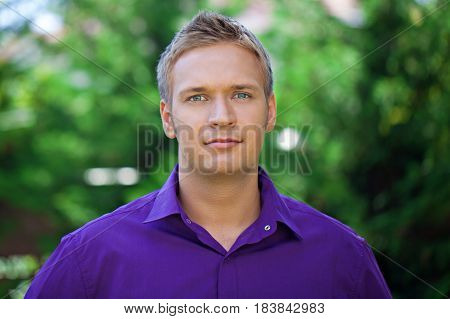Portrait photo of a male in a button down shirt