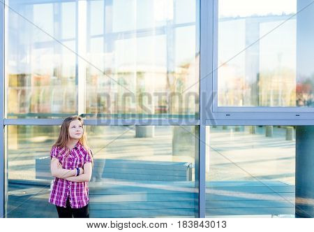 Girl Standing Near School And Looking Up