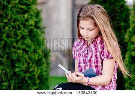 Girl Sitting And Reading A Book