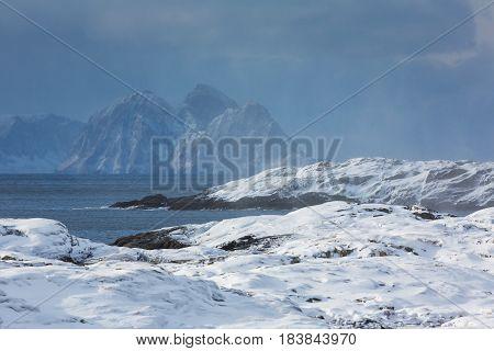 The snowy coast of the Lofoten Islands in winter