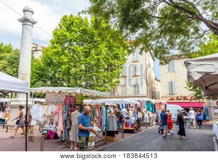 Antibes, France - June 30, 2016: day view of Place nationale with tourists and carousel in Antibes France. Antibes is a popular seaside town in the heart of the Cote d'Azur.