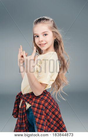 Girl Gesturing Rock Sign