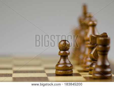 Pawn on Chessboard and Chess Piece in Background