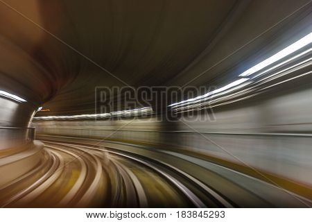 Inside tunel blur abstract scene traveling by train looking forward In Italian subway