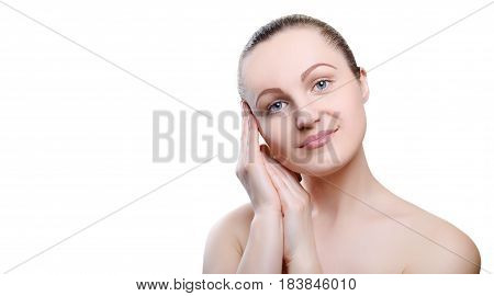 Portrait of a girl with nude make-up with hands near her face isolated on white background. Girl with clean healthy skin on white. Cosmetology spa medicine beauty care. Beauty model. Nude makeup