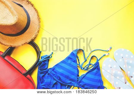 Flat lay of summer collection on yellow background with copy space