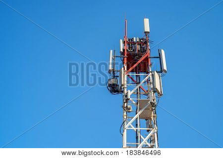 Top of telecommunication cellular radio tower on sky background
