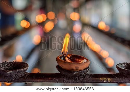 Coconut oil lamps for sacred fire in Buddha Tooth Relic Temple in Kandy, Sri Lanka