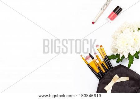 Makeup Brush In The Makeup, Red Lipstick, Pink Nail Polish And A Chrysanthemum Flower On A White Bac