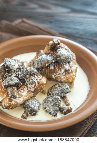 Portion of chicken with creamy mushroom sauce