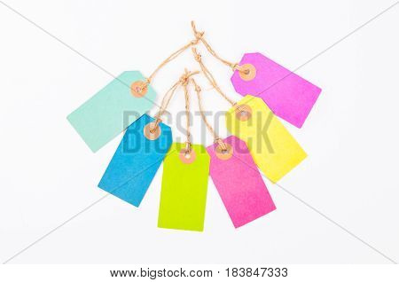 Many colorful of paper tag price on white background.