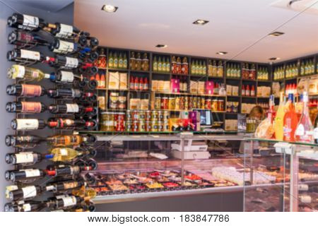 Blurred abstract background of shelf in supermarket interior