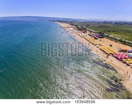 Drone flight over the sand beach of Crimea with tents