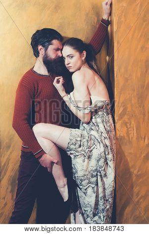 Serious Bearded Man Holding Sexy Raised Leg Of Pretty Girl