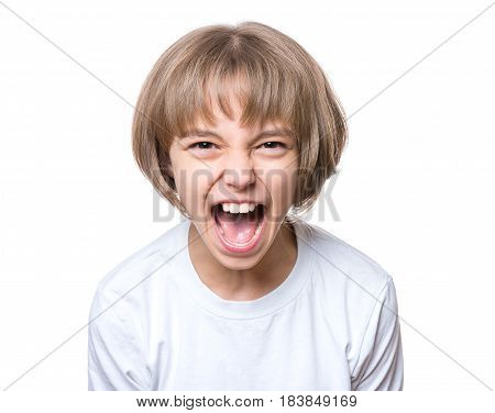 Close-up emotional portrait of attractive angry child teenager girl screaming wide open mouth. Funny cute child, isolated on white background. Negative human face expression. Conflict concept.