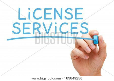 Hand writing License Services with blue marker on transparent wipe board.