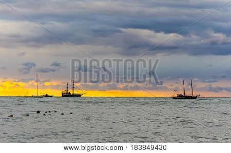 Beautiful seascape at sunset time with masted ships