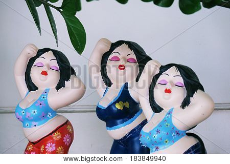 Home interior decoration of female, dances act statues
