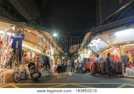 TAIPEI TAIWAN - DECEMBER 7, 2016: Unidentified people visit Wu Fen Pu street clothes market. Wu Fen Pu is best known for the massive wholesale garment market.