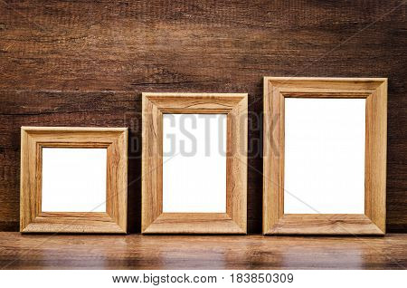 Set of collection blank wooden photo frame on wood table. save Clipping path.