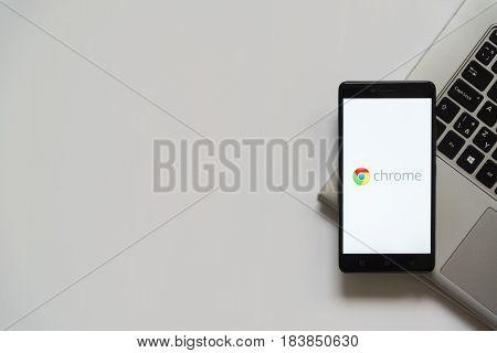 Bratislava, Slovakia, April 28, 2017: Google chrome logo on smartphone screen placed on laptop keyboard. Empty place to write information.