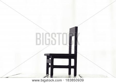 Chair silhouette wooden decoration on white window background