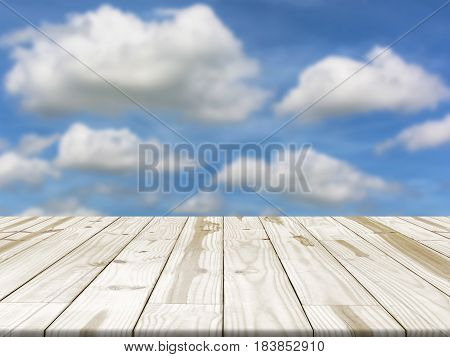Wood table top on Blue sky blurred in background. Empty table for display.