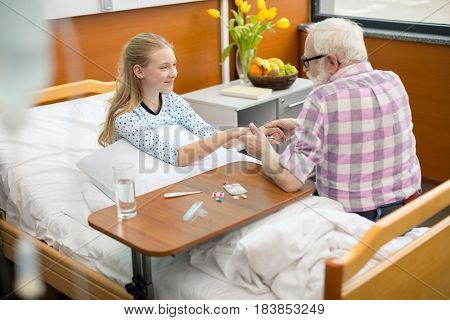 Grandfather And Child In Hospital