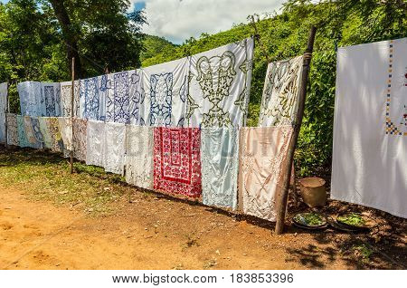 Ampasipohy Nosy Be Madagascar - December 19 2015: Selling embroidered tablecloths in the village of the Ampasipohy Nosy Be Island Madagascar. It is the traditional craft of this region.
