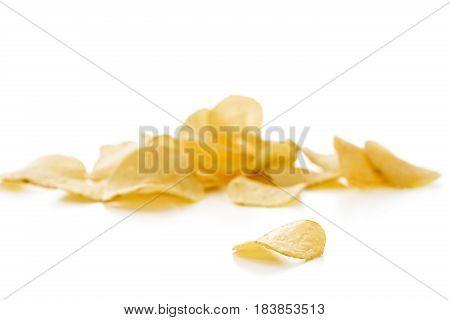 Crispy potato chips isolated on the white background  close-up