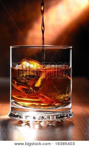 whisky beeing poured into a glass