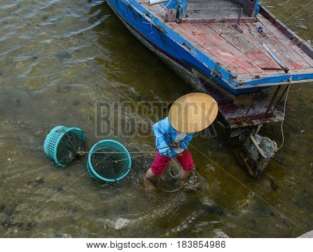 Woman Working On The Sea