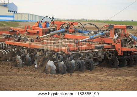 GOMEL, BELARUS - 19 APRIL 2017: Belarus tractor cultivates a piece of land