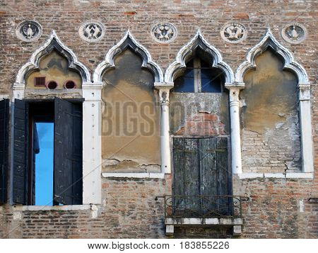 venice old building with ornate shuttered windows