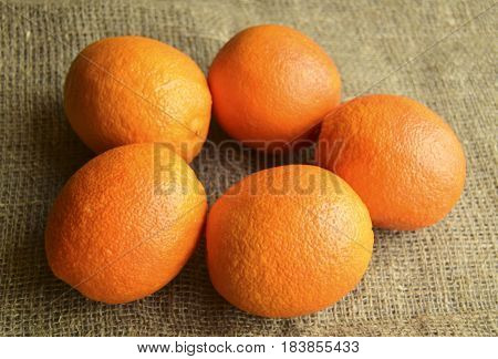 Oranges are on a table. Fruit are fresh juicy mature tropical.