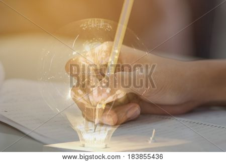 students hand testing doing examination with pencil drawing selected choice on answer sheets in school exam with light